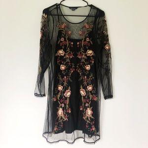 Black embroidered dress.